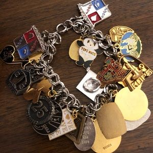 Jewelry - Vintage charm bracelet with several of charms.